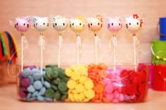 Hello Kitty cake pops in rainbow chocolate wafers.... any bright candy would work.