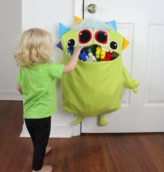 "How AWESOME are these monster toy storage bags? They make cleaning up FUN for kids because they can ""feed"" the monster their messes, they don't take up any floor space, AND they are all one of a kind – plus they are totally eco-friendly! 40 Diy Gifts, Diy Gifts For Kids, Toy Storage Solutions, Toy Storage Bags, Sewing Toys, Sewing Crafts, Sewing Projects, Monster Toys, Fun Diy Crafts"