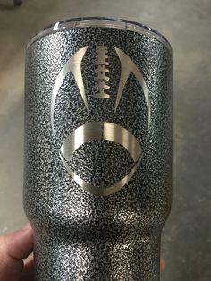 Football on Silver texture powder coat.  30 oz Yeti Rambler