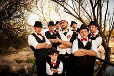 from my own wedding - vintage inspired groomsmen.  fedoras, vests, rolled up sleeves and bow ties.  even got the ring bearer dressed the same!  groom's wearing a white fedora with a red band i glued onto it, and a white bow tie.