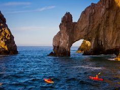 Kayakers navigate the waters around Land's End in Cabo San Lucas, a popular tourist destination at the southern tip of Mexico's Baja California peninsula. The continued coastal development of the nature-rich finger of land has raised questions about possible environmental damage