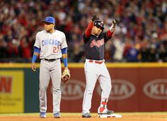 Cleveland Indians Jose Ramirez hit a leadoff double and points to the dugout in the bottom of the 6th against Chicago, in game one of the World Series, Tuesday, October 25, 2016.  Chicago Cubs shortstop Addison Russell  stands next to Ramirez at 2nd base.  Indians won 6-0 (Chuck Crow / The Plain Dealer)