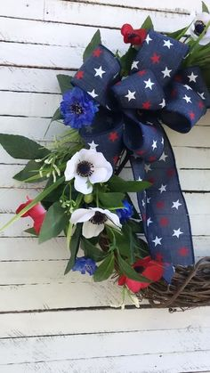 of July Wreath, Patriotic Wreath, Red White and Blue, Patriotic Wreath Patriotic Summer Wreath With red white and blue flowers with greenery in a grapevine wreath base. Show off your patriotism with this stunning wreath on your front door! White And Blue Flowers, Red And White, Patriotic Wreath, 4th Of July Wreath, Diy Wreath, Grapevine Wreath, White Wreath, Door Wreaths, 4th Of July Party