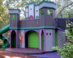 Barbara Butler's playhouses are a delightful inspiration.  Brightly stained, designed with loops of play in mind, and very climbable, they're cool.  The over the top Castle Dragon is the size of a small house, and has a theatre built into the castle!