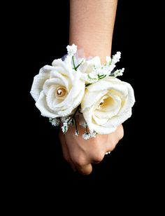 Brides & bridesmaids rose wrist corsage, for a wedding party. Handmade with plastic baby breath, ribbons, pearls, tulle and crepe paper roses.