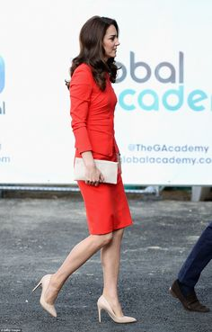 The Duchess of Cambridge, 35, chose a fiery red two-piece Armani suit for her visit to The Global Academy, to officially open the new state school