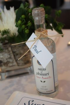 Mini Ouzo bottles. Place card and favor.