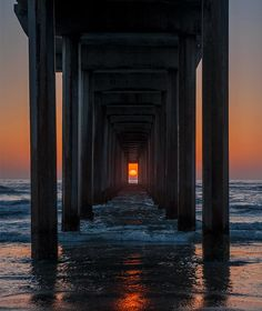 Twice a year, on the solstice, the sun lines up under the pier like this. Today is the solstice. - Imgur