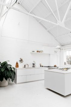 This all white studio loft is clean, bright and minimalist. It's concrete floors and white painted exposed brick continue the updated urban feeling