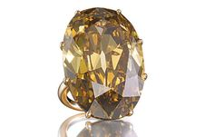 Ring set with a yellow 61.51 carat diamond, Siegelson, New York.