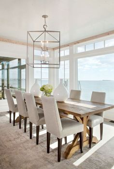 Interior Design Ideas | The table dining chairs and lighting in this dining room are from Lillian August.