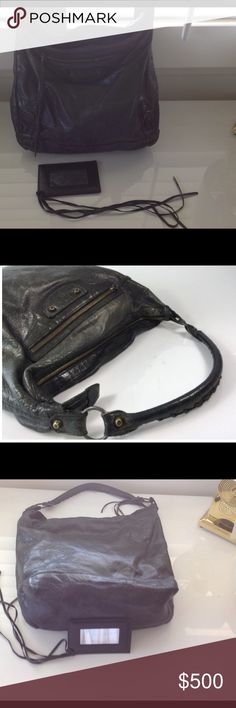 BALENCIAGA HOBO BAG💟💟 This bag is in mint condition, it's a dark gray distressed bag with mirror. All four corners are perfect as I never set my bags on the floor. My listing price will give you the Posh authentication so you can be sure you are getting an authentic bag. The inside is very very clean with one large zipper pocket.💕💗💞 Balenciaga Bags Hobos
