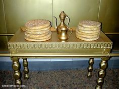 The Table of Showbread    Opposite the menorah was the table of showbread.  Built of acacia wood and overlaid with solid gold, the table had a surface of 3 x 1.5 feet (0.91m x 0.45m).      Twelve loaves of bread were placed on the table on Shabbat and were replaced by fresh bread the following Shabbat.  The high priestly line would eat the replaced bread.