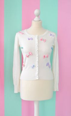 Pastel kawaii lolita cardigan with ribbons by MademoiselleOpossum  This would be really adorable with a pastel skirt c: I personally would use a pastel teal skirt (: