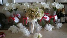 Bride's bouquet of green hydrangea studded with rhinestone brooches. Bridesmaids carried white calla lily wrapped in silver bling. Corsages were white calla lily and rhinestone bling stem