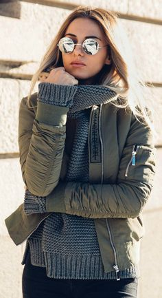 Bomber jackets + knitwear + Sendi Skopljak + cute winter + cable knit sweater + khaki bomber. Bomber jacket: Maniere De Voir, Sweater: Zara, Jeans: Nelly, Shoes: Isabel Marant, Sunglasses: La Moda. http://www.justthedesign.com/how-to-wear-a-bomber-jacket-bomber-jacket-outfits/