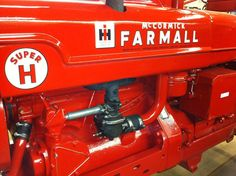 17 year old Riley's 1953 Super H Farmall tractor restoration won the national FFA competition.