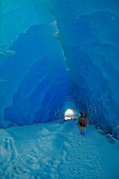 A man walks through a large ice tunnel formed by the shifting of icebergs along the terminus of the Mendenhall Glacier in Juneau, Alaska. Walking on the frozen waters leading up to the glacier… Juneau Alaska, Alaska Travel, Mendenhall Ice Caves, Places To Travel, Places To See, North To Alaska, Alaska Usa, Alaskan Cruise, Cultural Experience
