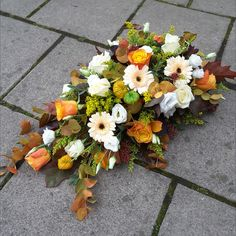 A autumnal single ended spray in white roses and lisianthus, peach germini, orange roses, yellow solidago, lanterns, and oak leaves. Orange Roses, White Roses, Florist London, Funeral Tributes, Same Day Flower Delivery, Oak Leaves, Autumnal, Lanterns, Floral Wreath