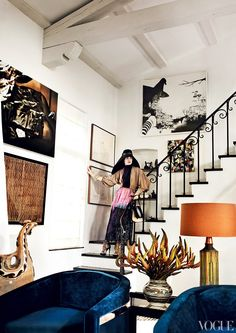 Mario Testino's dramatic Los Angeles escape is flush with iconic, well-travelled accoutrement. Marrakech rugs, Peruvian pottery, and modern minimalism manage to flawlessly come together under one roof. Everything from velvet barrel back Milo Baughman club chairs to a couture-clad model casually descending the staircase feels completely at ease in this artful and eclectic abode.