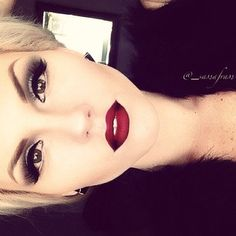 Classic wing eyeliner with dark red lips