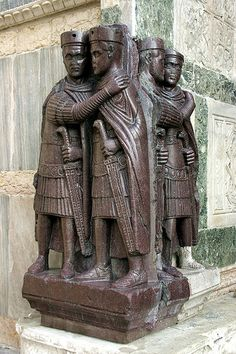 "The tetrarchs (from the Greek words for ""Four rules"") were the four co-rulers that governed the Roman Empire as long as Diocletian's reform lasted. Here they were portraied embracing, in sign of harmony, in a porphyry sculpture dating from the 4th century, produced in Asia Minor, today on a corner of Saint Mark's in Venice, next to the ""Porta della Carta""."