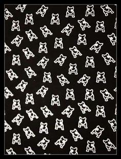 *zwarte stretchstof met witte hondjes*