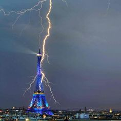 A lightning bolt appears to strike the Eiffel Tower in Paris