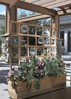 Planter and trellis for the deck! Love the tea light holders on the trellis!!