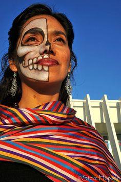 Artist Yuyi Morales with a painted face at a Día de los Muertos celebration. . Photo © Steve Hopson,2008.