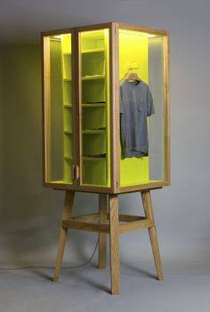 Work the yellow into wooden till panel Possible to put glass doors onto panel create a luxury cabinet feel?