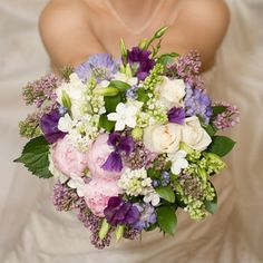 Posted on: Apr 5, 2011. by: bollea in Bouquet Wedding  Spring bridal bouquet    A compactly gathered hand tied bouquet of spring flowers featuring purple lilac, stephanotis blossoms, peonies, lisianthus, and sweet peas.