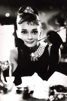 Audrey Hepburn wields a cigarette holder in her role as the charming gold-digger Holly Golightly in 'Breakfast at Tiffany's', directed by Blake Edwards. Audrey Hepburn Smoking, Marilyn Monroe And Audrey Hepburn, Audrey Hepburn Breakfast At Tiffanys, Aubrey Hepburn, Audrey Hepburn Photos, Audrey Hepburn Style, Audrey Hepburn Wallpaper, Blake Edwards, Anna Dello Russo