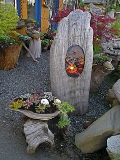 garden lighting # DRIFTWOOD ART -Even tho this has a glass insert , I think just the oval cut out would be good, amp; or a piece of wirenetting with some tucked in.(Fused glass light in driftwood with driftwood planter(-jbell) Driftwood Planters, Driftwood Projects, Driftwood Art, Painted Driftwood, Garden Crafts, Garden Projects, Light Crafts, Yard Art, Amazing Gardens