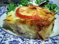 a hearty serving of 'rumbledethumps' ... a savory dish made of potatoes, cabbage/kale, onions/chives, cheese (sometimes turnips are added), and this version topped with sliced tomatoes