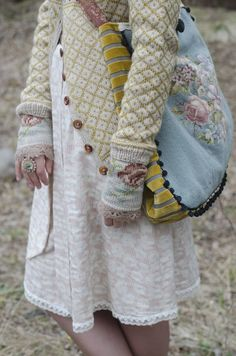 Wiola-strikk. So many things I like about this. The added cuffs to the sweater, the purse. Not sure where to pin it!
