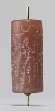 Cylinder Seal with Winged Deities [between 900 and 700 BC (Neo-Assyrian)]