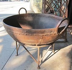 Iron Kadi Fire Bowl.  Originally used as a large cooking pot and perfect for a outdoor fire bowl.  Raw iron with studs and reinforced iron straps. Comes with an iron stand.