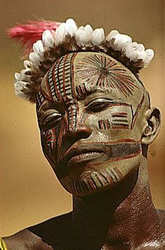 The more beautiful the mask is the more success with the girls. A Nuba of Kau, Sudan, with his unusual mask. Photo by Leni Riefenstahl, 1970's.