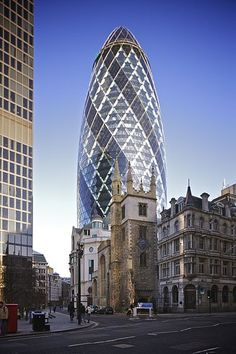 30 St Mary Axe (formerly the Swiss Re Building) - a skyscraper in London's financial district, the City of London, completed in December 2003 and opened at the end of May 2004. With 40 floors, the tower is 180 metres (591 ft) tall, and stands on the former site of the Baltic Exchange building.