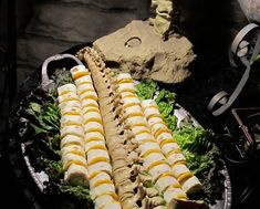 Eerie Elegance, yes please! - Halloween platter idea - stack turkey rolls and put sliced cheese between each vertebrae - idea only halloween dinner Halloween Dinner, Theme Halloween, Halloween Food For Party, Adult Halloween, Halloween Treats, Fall Halloween, Halloween Foods, Halloween Breakfast, Halloween Appetizers For Adults