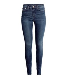Shaping. 5-pocket jeans in washed denim with technical stretch to trim and shape tummy, thighs and seat, while jeans maintain their shape. Regular waist and ultra-slim legs.