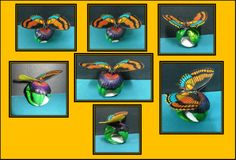 Mariposa reposando sobre una flor- Hecho en tagua- Disponible en Weil Art