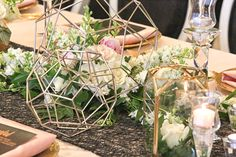 I used Geometric Figurines as armatures for the floral designs and geometric glass lanterns.  Table centerpiece design and floral by Lana with FairbanksFlorist.net, photo ArtFaulkner.com