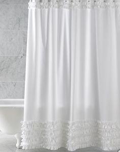 Ann Gish ruffled shower curtain - I got one for my mommy too :)