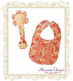 Alimrose Designs Git Set Floral Pop  Alimrose Designs sweet ruffle bib and hand rattle make a beautiful gift for new baby girl or baby shower gift!  $29.95