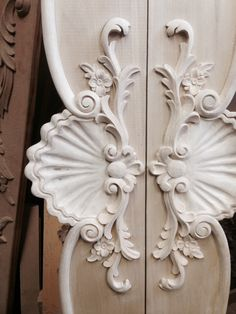 Completed hand carving for a pair of built in armoire china cabinets. Designed & manufactured by Auffrance.