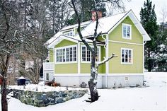 At Home with Abrahamson in Nacka - facade - LOVE the color!!The facade is painted with an olive green linseed oil. Maria found the color of an old Cabin on Boat from the 1800's and got a paint chip that Culture artisans then hand mixed.