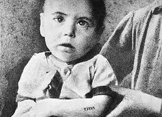 Although mothers tried desperately to hide and protect their children, few as young as this child, tattooed with the number survived Auschwitz Concentration Camp.