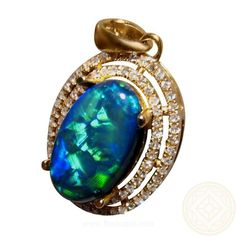 Stunning Black Opal and Diamond pendant in 14k Gold with an long oval 2.8 carat Lightning Ridge Black Opal surrounded by a two rows of  of diamonds with a total of 80.  The Black Opal will be securely set after purchase which means you can have the choice of 14k Gold color or you can even have the Opal set into a different pendant or ring setting.  Contact through the product for assistance. #opalsaustralia